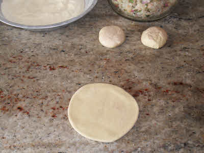 Roll the dough for aloo parantha