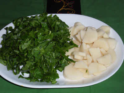 Chop spinach and potatoes