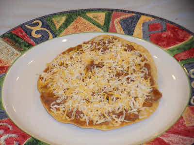 Top the tostada with cheese