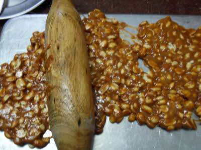 Flatten the chikki mixture using the rolling pin
