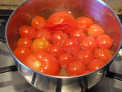 Cook tomato for Creamy Tomato Soup