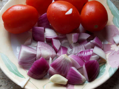 Chop onions roughly for roasted tomato chutney