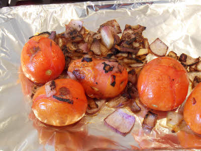 Baked onion, tomato, garlic for roasted tomato chutney