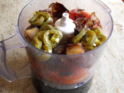 Add chopped jalapenos and blend