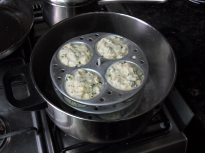 Idli mold in the boiling water