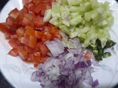 Chop vegetables for peanut bhel