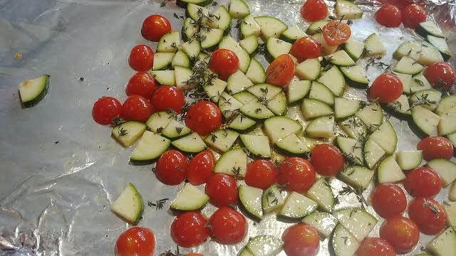 Toss tomatoes, zucchini and half of thyme