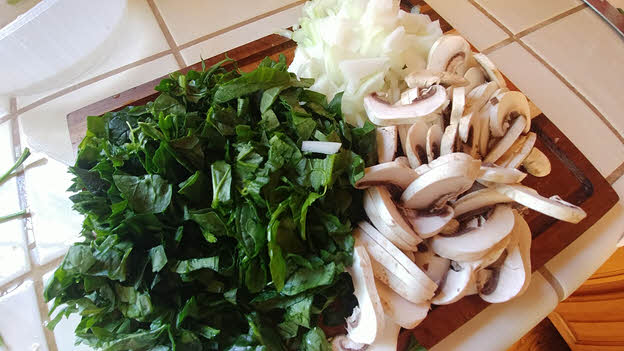 Chop spinach, mushrooms and onions