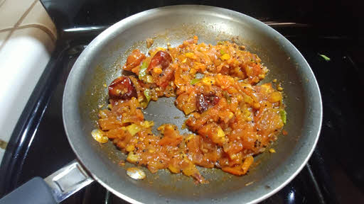 Cook tomatoes, kari leaves and salt