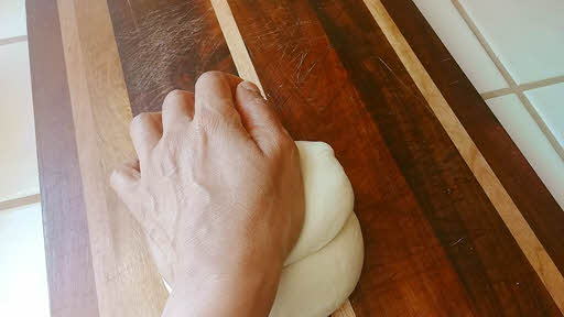 Use the stretch and roll method until the dough is silky smooth