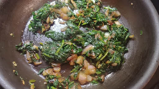 Saute onion and spinach for pudding