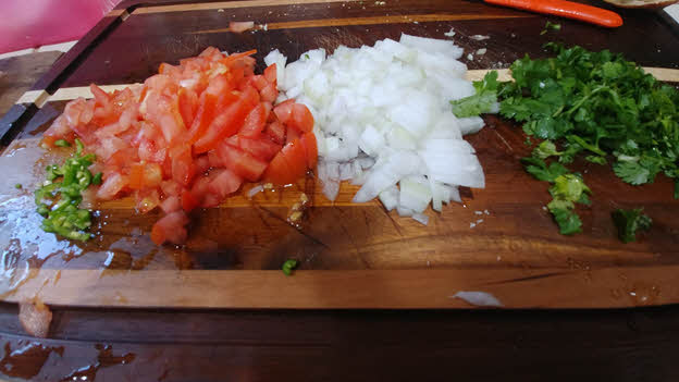 chop tomato, onion, green chillies and fresh cilantro finely