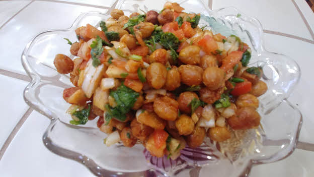 Toss chickpeas with tomato, onion, chillies