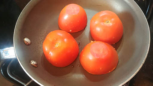 Cook stuffed tomatoes