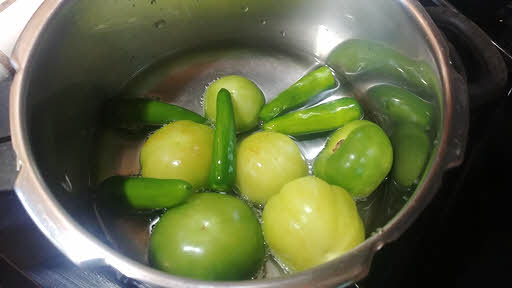 Boil tomatillos and peppers
