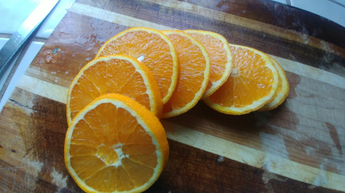 Cut orange in about 3/4 cm thick slices