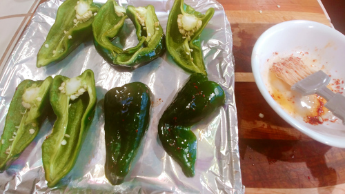 smear the outer side of the peppers with a little chilli oil